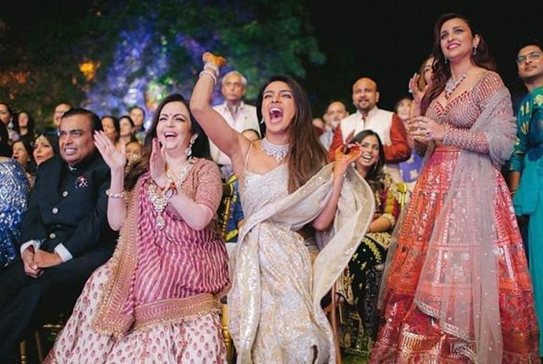 Priyanka cheering with Ambanis