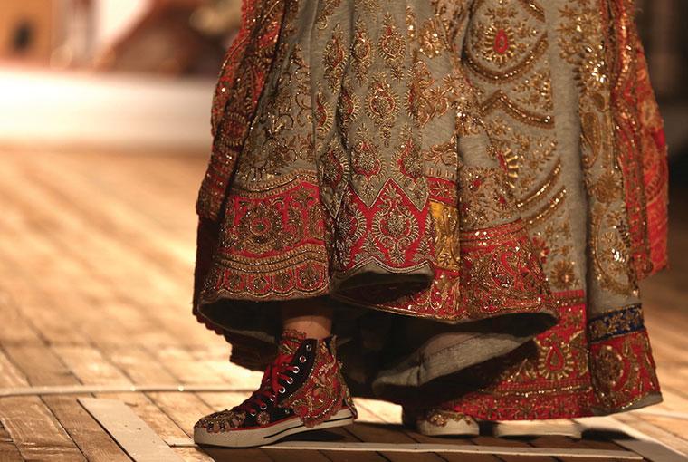 Embellished sneakers by Monisha Jaising